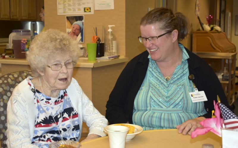 -Messenger photo by Chad Thompson  The Rev. Jennifer Osheim-Owen, right, visits with Helen Nibel, left, at Friendship Haven, recently. Nibel is a resident at Friendship Haven. Osheim-Owen is the new chaplain there.