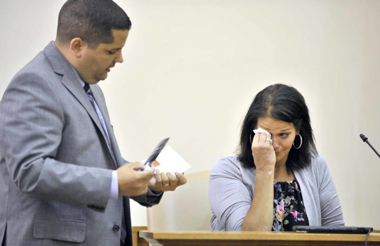 -Messenger photo by Hans Madsen  Cricket Pederson, of Fort Dodge, looks over several evidence photos with Webster County first-assistant attorney Ryan Baldridge as she testifies Tuesday during the third-degree kidnapping and eluding trial of Reino Bodady, 34, of Fort Dodge in Webster County District Court. Bodady is accused of tying up Pederson and driving her around Fort Dodge before he was apprehended by Fort Dodge Police.