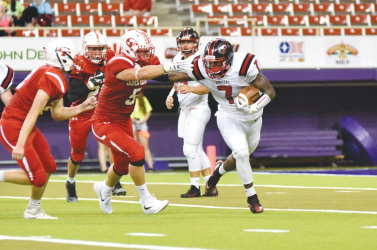 -Messenger photo by Britt Kudla Joe Artis of Fort Dodge stiff arms Cedar Falls Colin Klatt on Friday inside the UNI Dome