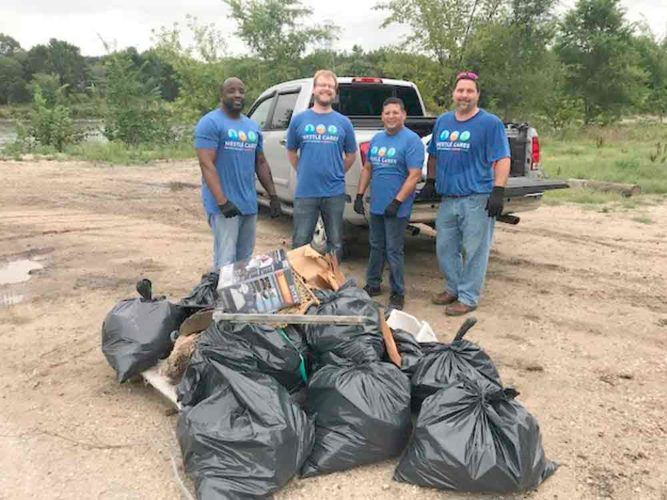 Purina employees in Fort Dodge took part in Nestle's annual nationwide volunteer day on Aug. 17, which included 6,000 Nestle employees at 150 volunteer sites around the U.S. Purina  employees cleaned up the areas along Little Dam and the Des Moines River. In the six hours spent cleaning, they ended up with about 50 full bags.  From left, Purina employees Lance Lockman, Brad Muller, Sonny Rivera and Justin Wolfe clean up the west side of Little Dam.