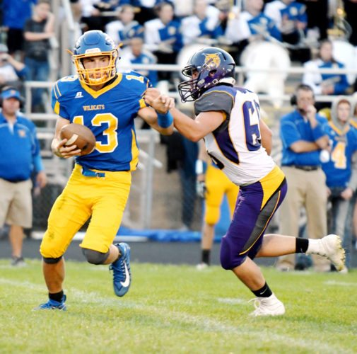 Photo by Troy Banning, for The Messenger  Jamison Heinz of Humboldt tries to scramble away from trouble against Webster City last week.