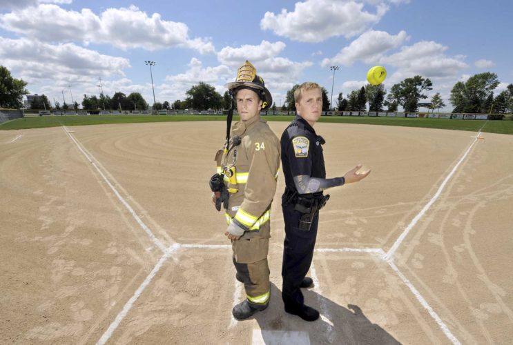 -Messenger photo by Hans Madsen Fort Dodge firefighter Zach Rickman, along with Fort Dodge Police Officer Cody Harris, demonstrates the squaring off that will occur on Sept. 10 during the Guns & Hoses softball game at the Harlan and Hazel Rogers Sports Complex.  The Serving Our Servants-hosted game is a fundraiser to benefit D/SAOC and the 133rd Test Squadron. The first pitch is at 5 p.m.