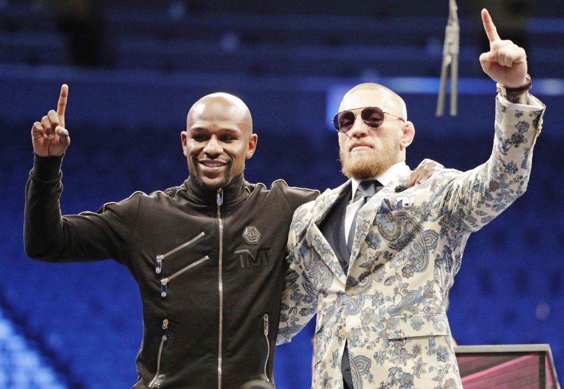 AP Photo  Floyd Mayweather Jr. and Conor McGregor pose together at a press conference in Las Vegas.