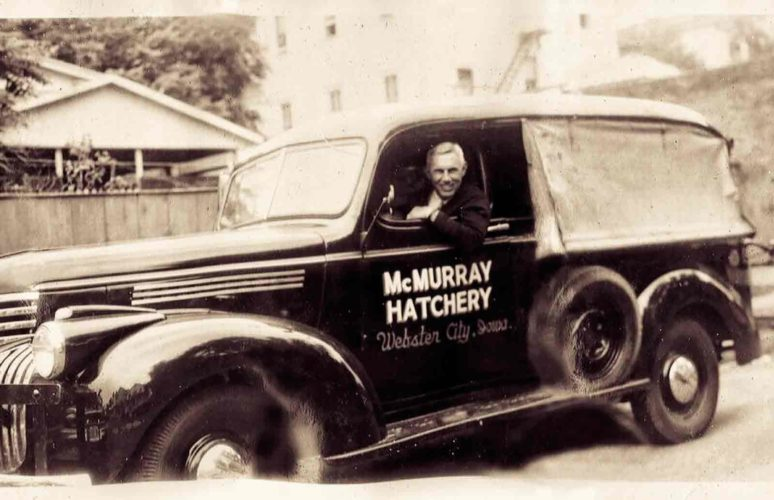 -Submitted photo  Murray McMurray is shown here in the delivery truck in the early days of McMurray Hatchery, which was founded in Webster City and still does business in Webster City.