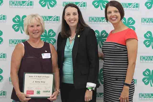 Kitty Drey, of Sac County, was inducted into the 2017 Iowa 4-H Hall of Fame during a ceremony at the 4-H Exhibits Building at the Iowa State Fair. Ninety-two Iowa counties participated this year and have selected 119 inductees for their outstanding service and dedication to 4-H. Inductees or their surviving family members were presented a certificate as they were introduced on stage. Pictured are Drey, Iowa 4-H Foundation Director Emily Savereid and Iowa 4-H Volunteer SpecialistTillie Good.