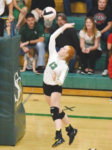 -Messenger photo by Britt Kudla Hannah Schaeffer of St. Edmond goes up for a spike against Algona on Thursday