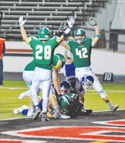 —Photo by TomVogt  St. Edmond's Jake Rossow (28) and Jackson Bemrich (42) hold up the touchdown signal after Andrew Gibb plunged into the end zone.