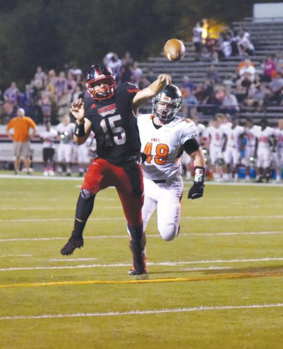 -Messenger photo by Britt Kudla Drake Miller of Fort Dodge throws a touchdown to Tyrnan Lara against Ames on Friday