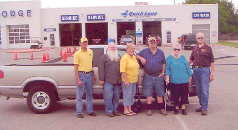 Helen Keyser was the winner of the Fort Dodge Evening Lions pickup raffle. Pictured from left are Earl Possehn, Gary Edgerton, Rosemary Possehn, Joe Lewis, Keyser, and Bill Oberhelman, chairman of the raffle project.