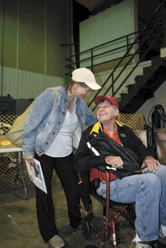 -Messenger photo by Chad Thompson  Craig Conway, a Vietnam veteran from Webster City, right, visits with his wife, Wanda Conway, prior to the Brushy Creek Area Honor Flight Saturday morning.