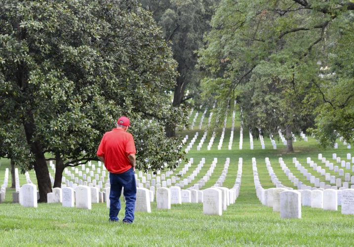 -Messenger photo by Kriss Nelson  Jim Hruska of Fort Dodge takes some time at Arlington National Cemetery to remember the fallen.