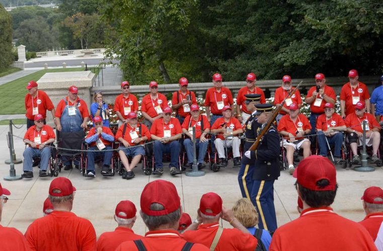 -Messenger photo by Kriss Nelson   Members of the Brushy Creek Area Honor Flight watch the changing of the guard at the Tomb of the Unknown Soldier in Arlington National Cemetery during their trip Saturday.