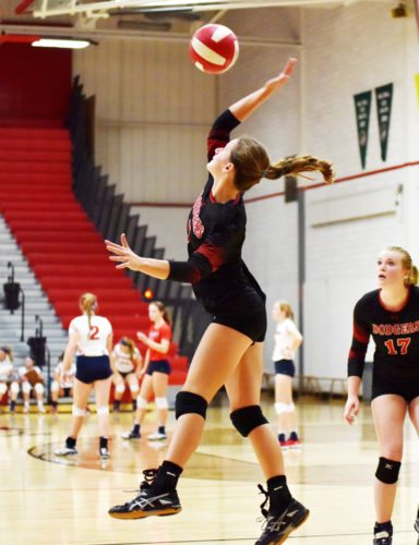 Messenger photo by Britt Kudla  Brooke Erickson of Fort Dodge returns a shot in the Dodger gym last Saturday.