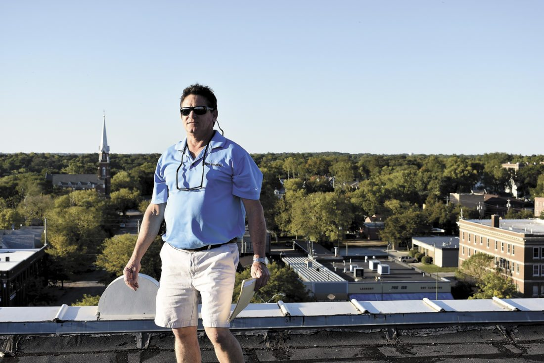 -Messenger photo by Chad Thompson  Matt Doyle, owner of the historic Snell Building, stands on its rooftop Wednesday evening during a historic architecture walk hosted by Main Street Fort Dodge.The building was built in 1914 using glazed brick, which was the most expensive brick available at the time at $65 per 1,000, according to Doyle.