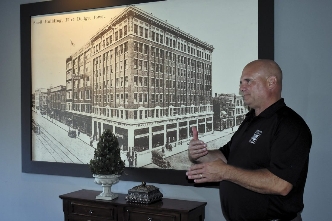-Messenger photo by Chad Thompson  Tim Reinders, design specialist with Main Street Iowa, talks about downtown Fort Dodge inside the Snell Building Wednesday evening.