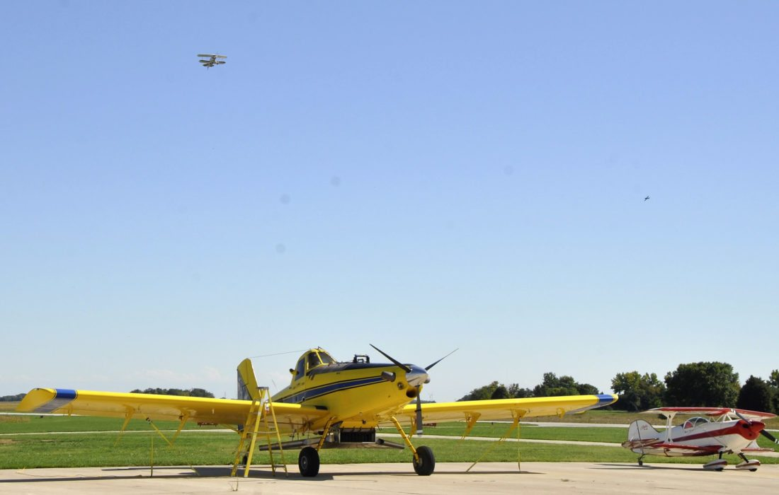 -Messenger photo by Joe SutterCory Johnson takes off in a tiny Pitts aerobatic biplane, over this much larger parked Air Tractor crop duster and another Pitts at the Pocahontas Municipal Airport.