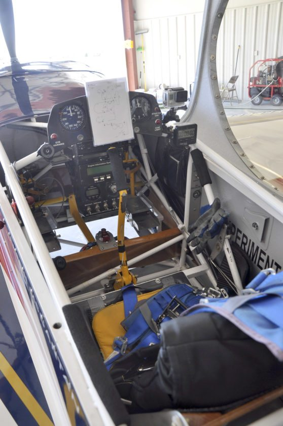 -Messenger photo by Joe Sutter The cockpit of Aaron McCartan's Panzl S-330 stunt plane is sparse, with nothing extra that could add weight. At center is the sheet listing every move required in McCartan's upcoming run; points will be deducted for each maneuver not completed or not done well. The rear seat cushion is his parachute.