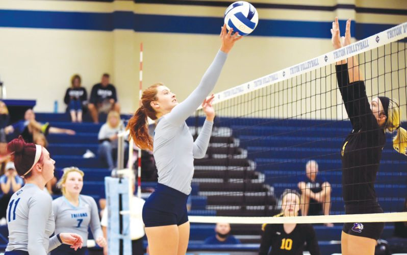 -Messenger photo by Britt Kudla Lexi Green of Iowa Central hits the ball over Ellsworth Nicole Nielsen on Wednesday