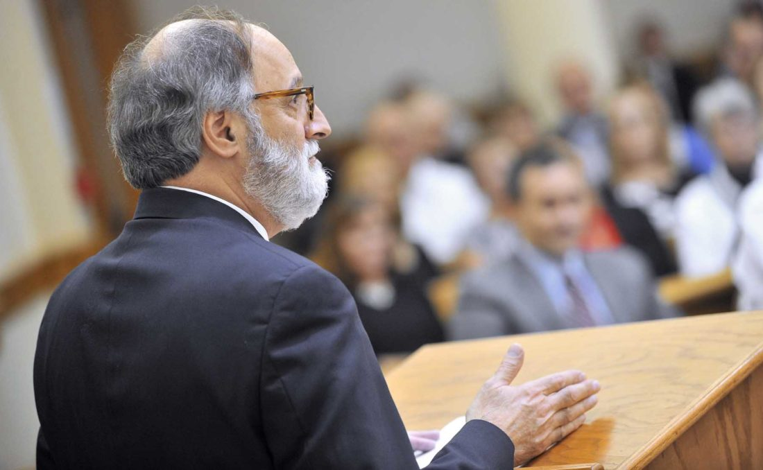 -Messenger photo by Hans Madsen  Magistrate William Habhab speaks about attorney Joe McCarville's career Thursday afternoon during McCarville's investiture as a District Associate Judge.