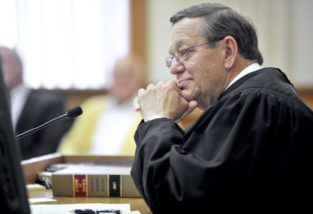 -Messenger photo by Hans Madsen  Chief Judge of the Second Judicial District Kurt Wilke precided over the investiture of Fort Dodge attorney Joe McCarville to a District Associate Judge's position.