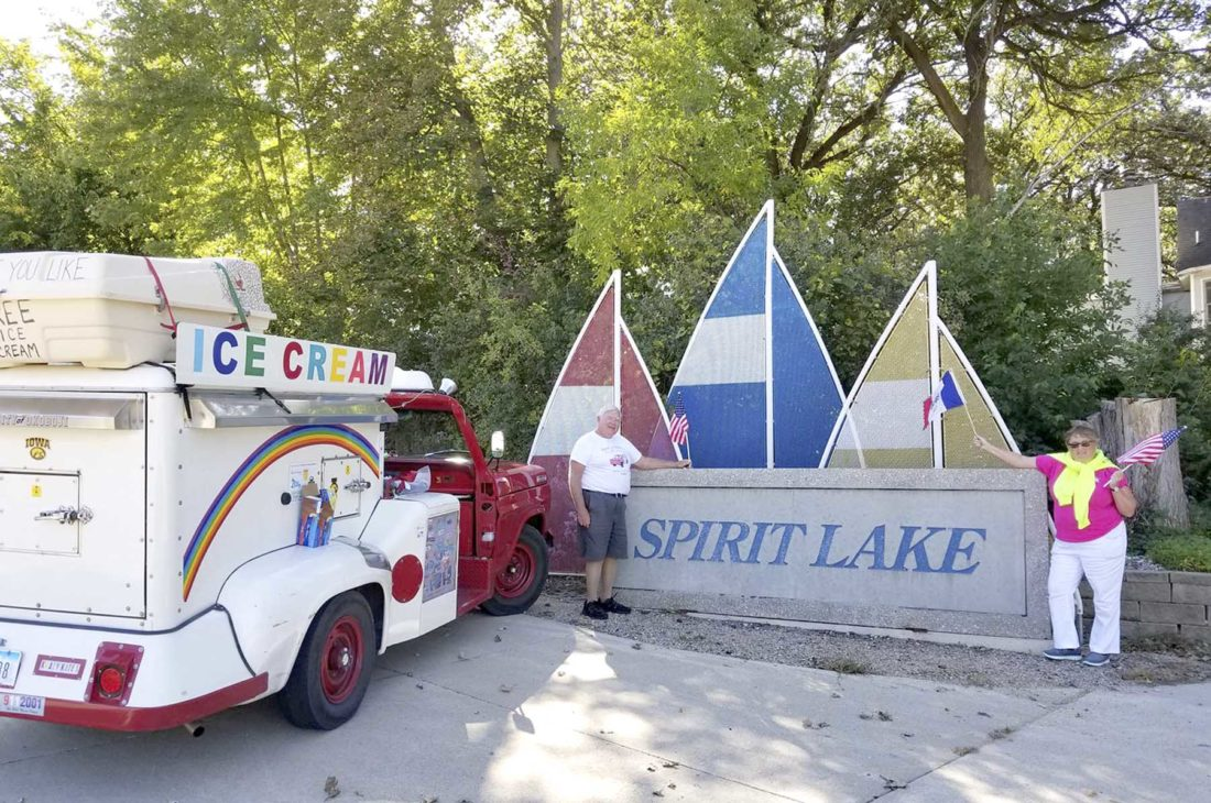 -Submitted photo   Bob Shaw, left, and Kate Shaw, of Spirit Lake, stand near a Good Humor ice cream truck after returning home from delivering free ice cream around the state of Iowa recently. The two have been married 50 years. The trip lasted 15 days and spanned 1,400 miles.