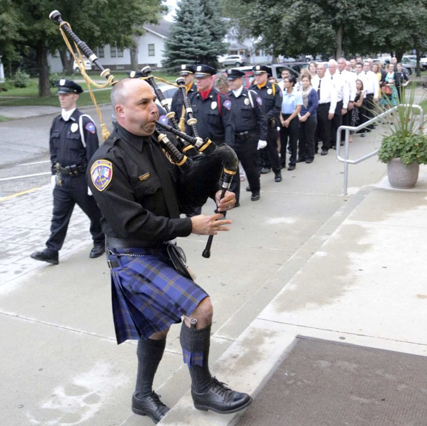 -Submitted photo Sgt. Mike Manthorne of the Sioux City Police Department leads the procession of police officers, firefighters and emergency medical personnel into St. Mary's Church for a previous Blue Mass celebration.
