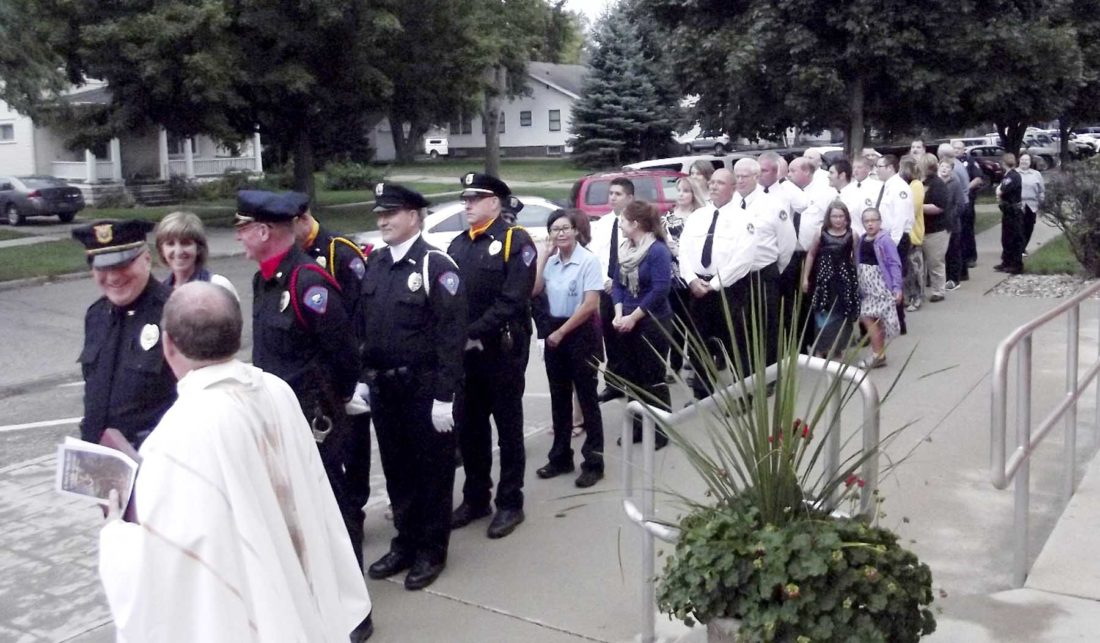 -Submitted photo Police officers, firefighters, emergency medical personnel and their families line up for a procession before a previous Blue Mass at St. Mary's Church.