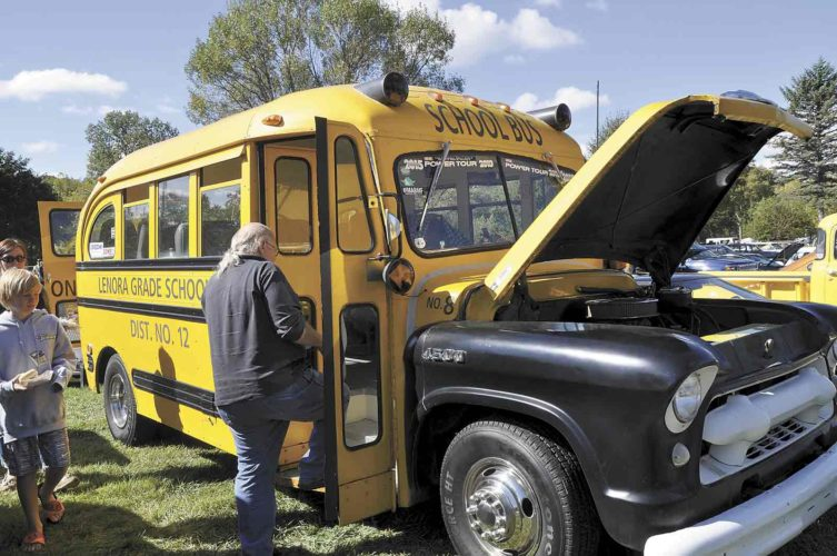 During the 2016 Cruise to the Woods car show, Robin Marler, of Omaha, climbs on board a 1955 Chevrolet School Bus that a group of 10 friends built and customized. The bus has a 460 engine making 480 horsepower, and has been on power tours all across the country.