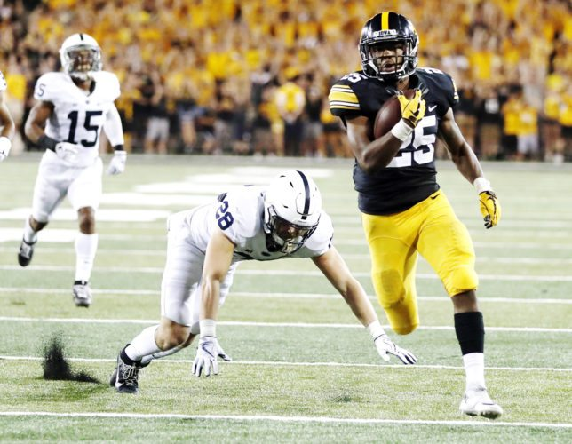 AP Photo/Jeff Roberson  Iowa running back Akrum Wadley scores against Penn State on Saturday night at Kinnick Stadium in Iowa City.