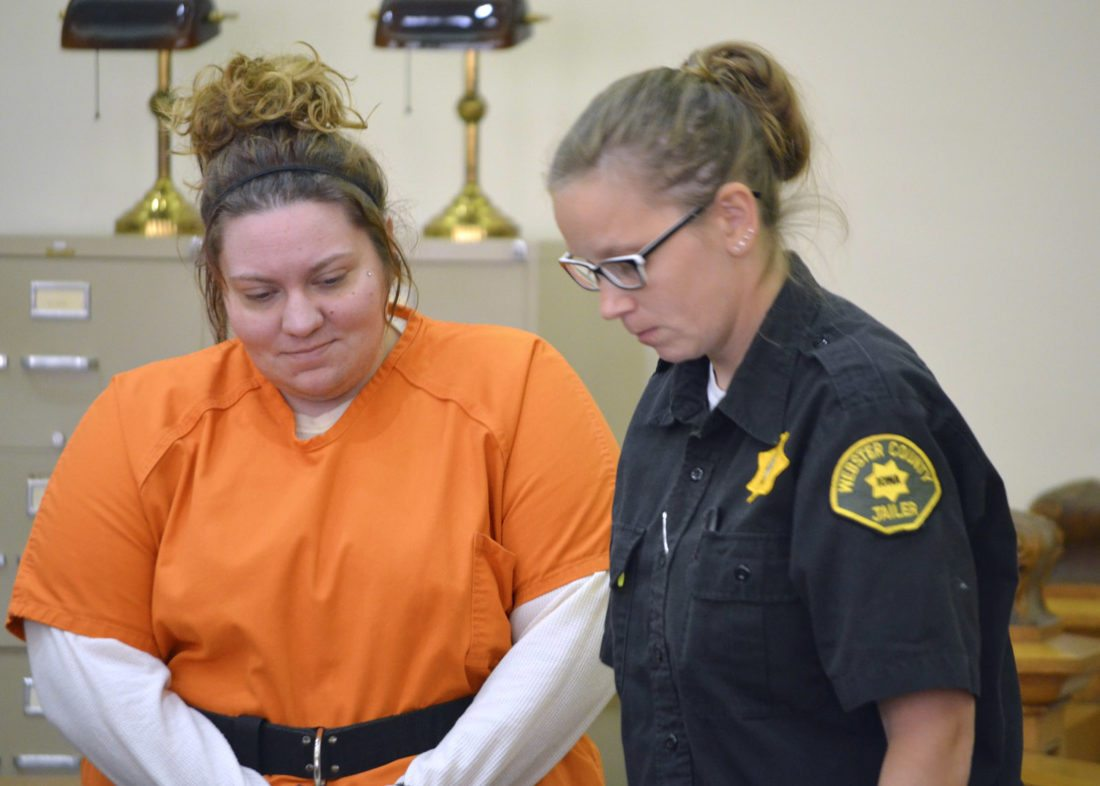 -Messenger photo by Peter Kaspari  Mackenzie Knigge, left, is led out of the courtroom at the Webster County Courthouse by Sgt. Shawna Dencklau, of the Webster County Jail, Monday afternoon. Knigge pleaded not guilty to killing Jessica Gomez.