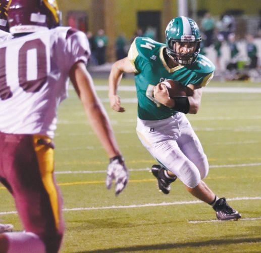 -Messenger photo by Britt Kudla Cade Naughton of St. Edmond scores a touchdown against Hartley-Melvin-Sanborn on Friday