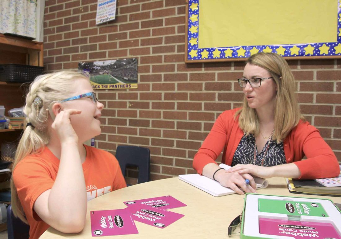 -Submitted photo  Julianne Cooke, left, a student at Humboldt Community Schools, works on exercises to help her brain connect words and pictures with Elizabeth Cooper, right, a teacher of the deaf and hard of hearing with Prairie Lakes AEA.