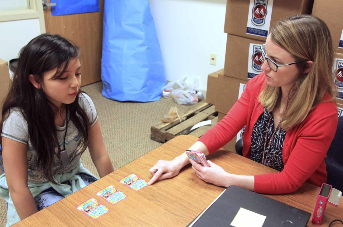 -Submitted photo  Elizabeth Cooper, right, leads Yasmine Martinez in exercises to help build vocabulary, conversation and thinking skills. Martinez is a student at Eagle Grove Community Schools.