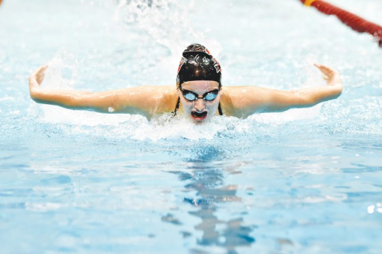 -Messenger photo by Britt Kudla  Taylor Hartley of Fort Dodge compete during the girls 100 Yard Butterfly on Tuesday