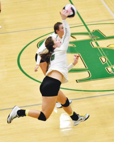 -Messenger photo by Britt Kudla Erin Flattery of St. Edmond goes up for a spike against Manson NW Webster on Tuesday