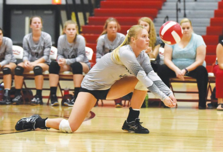 -Messenger Photo by Britt Kudla Beth Murman of Fort Dodge dives for a ball against Urbandale on Tuesday
