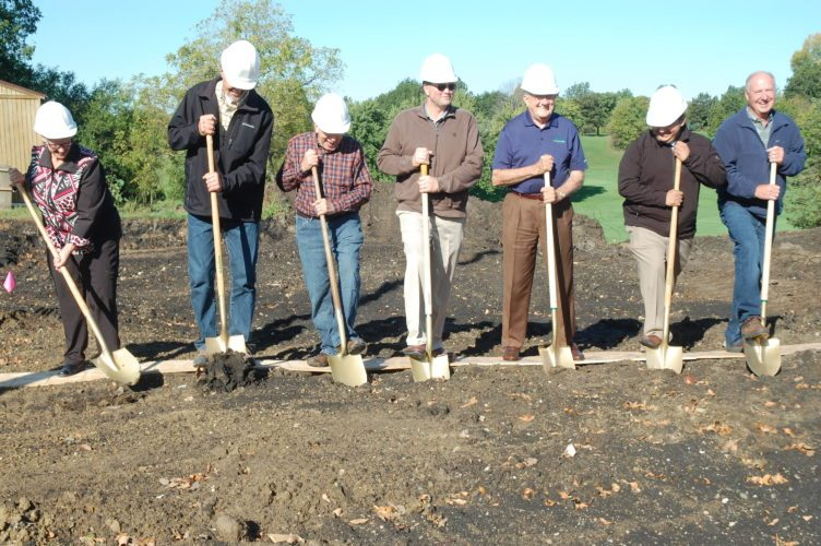 -Messenger photo by Anne Blankenship  Ground was broken for the new Briggs Woods Conference Center project Wednesday morning. Turning over  the  soil were, from the left, Diane Sinclair, Hamilton County Conservation Board chairman; Hamilton County Supervisors Dan Campidilli and Doug Bailey; Chip Abbott, representing Webster City Custom Meats; Bob Van Diest, of Van Diest Supply Co.; Daniel Ortiz-Hernandez, city manager of Wester City; and Hamilton County Supervisor David Young. The $2.6 million project is expected to be completed in late 2018.