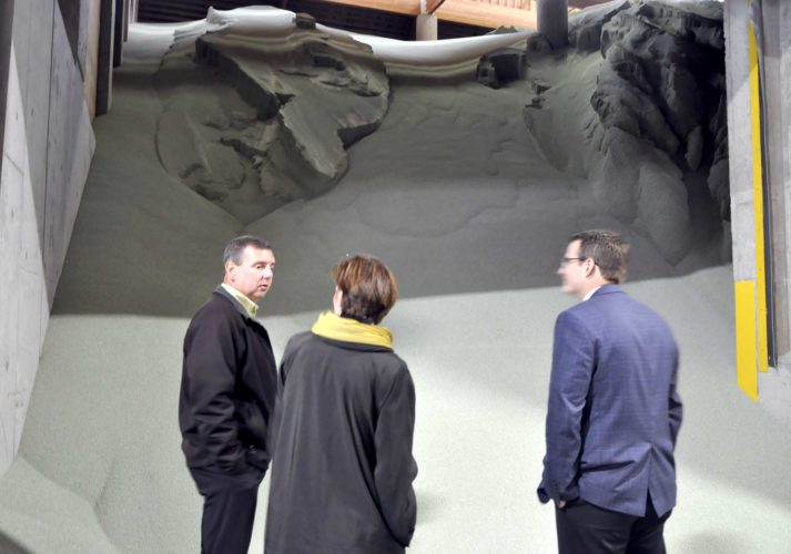 -Messenger photo by Peter Kaspari  Dan Dix, left, general manager of NEW Coop, Gov. Kim Reynolds and Acting Lt. Gov. Adam Gregg tour the cooperative's Roelyn facility Thursday