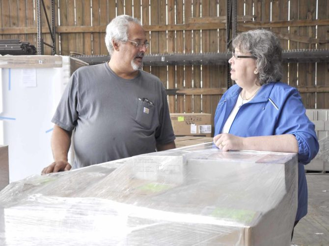 -Messenger photo by Peter Kaspari Dennis Ramthun, left, of Ramthun Trucking, speaks with Ellie Menz, disaster relief coordinator, as they prepare to load a truck of supplies that will travel to Houston, Texas, which was recently hit by Hurricane Harvey.  Dennis Ramthun, left, of Ramthun Trucking, speaks with Ellie Menz, of Lutheran Family Services, as they prepare to load a truck of supplies that will travel to Houston, Texas, which was recently hit by Hurricane Harvey.