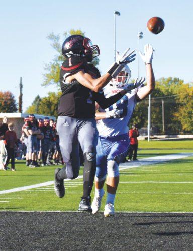 -Messenger photo by Britt Kudla Tysen Kershaw of Fort Dodge makes the catch for a touchdown against Marshalltown on Saturday inside Dodger Stadium