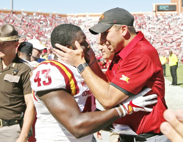 —AP Photo/Sue Ogrocki  Iowa State head coach Matt Campbell celebrates with linebacker Tymar Sutton (43) after the Cyclones' upset victory against the third-ranked Sooners on Saturday in Norman, Okla.