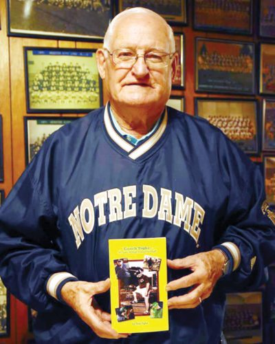 Submitted photo by David Borer  Legendary coach Dick Tighe stands with his new book at his home recently.