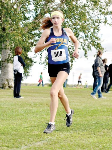 -Messenger photo by Britt Kudla Bryce Gidel of Humboldt compete during the girls 5k run on Tuesday at River Road Golf Course