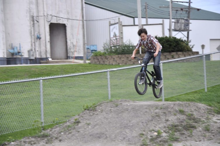 -Messenger photo by Joe Sutter  Cayden Gascho, 13, hits one of the jumps at the new Badger BMX park. Students like Gascho brought their idea for a park to the City Council, and worked to find sponsors and raise the money for it.