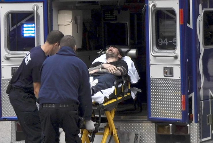 -Messenger photo by Joe Sutter  Paramedics load Chad Panzi into an ambulance after he was arrested following a chase that ended at 701 Forest Ave. Fort Dodge police said Panzi was tazed after he refused to put his hands up. Police assissted U.S. Marshals in serving a federal arrest warrent.
