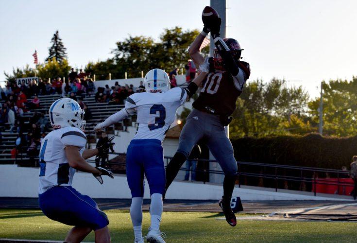 -Messenger photo by Britt Kudla Tyrnan Lara of Fort Dodge catches a pass from Drake Miller for a touchdown against Marshalltown on Saturday inside Dodger Stadium