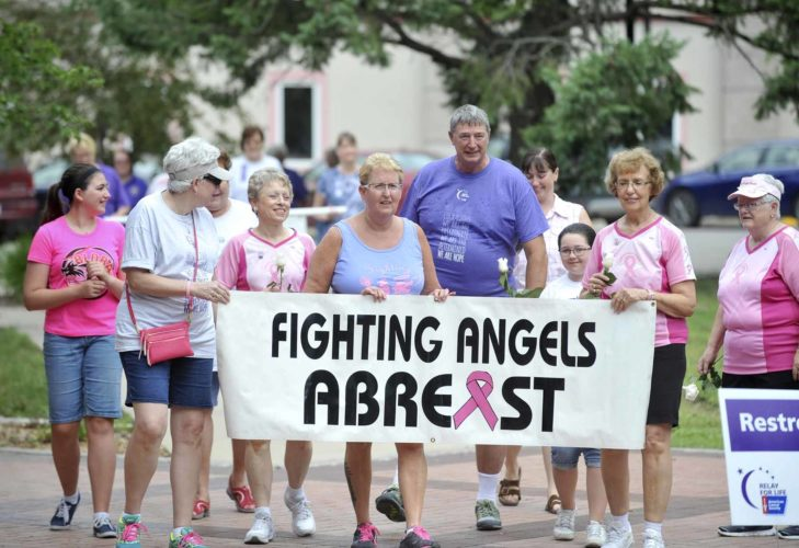 -Messenger photo by Hans Madsen  Members and supporters of the Fighting Angels Abreast dragon boat team walk around the City Square during the American Cancer Society Relay for Life of Webster County fundraiser.