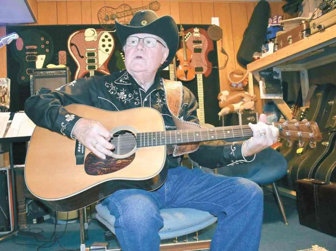 -Messenger photo by Chad Thompson  Bobby Awe, of Fort Dodge, performs in his studio recently.