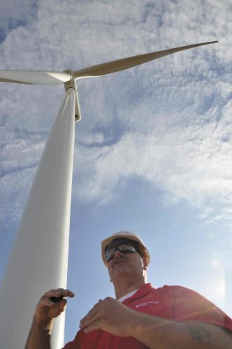-Messenger file photo by Joe Sutter  LEFT: Wind Operations Supervisor Bill Nobisch explains wind power during an October 2014 tour of the Lundgren Wind project, part of MidAmerican's Wind 8 initiative. MidAmerican is now bringing more turbines to Iowa with a Wind XI  project, and retrofitting old turbines to make them more powerful.