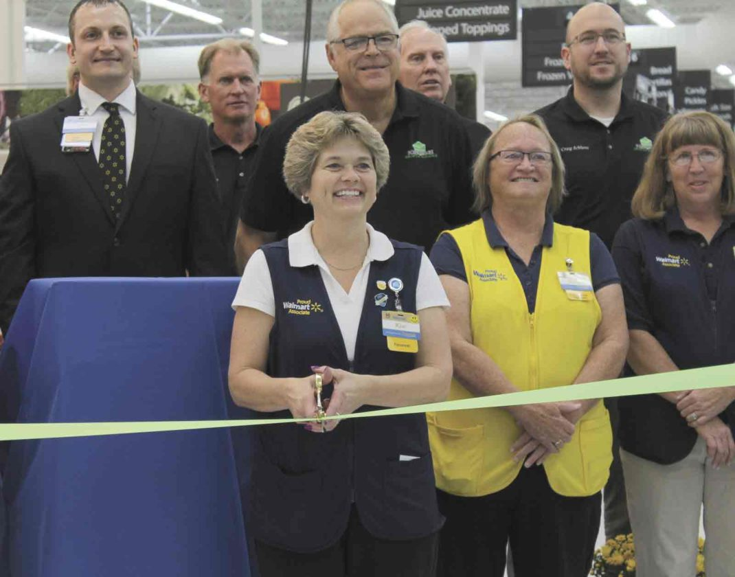 The Fort Dodge Walmart store recently held a ribbon cutting to celebrate a $5 million remodel. Pictured in front from left are HR Manager Kim Scott, Front End Supervisor Vicky Ruby and Pharmacy Manager Cindy Meythaler. In the second row are store Manager Brad Henderson and Steve Pederson from the Greater Fort Dodge Growth Alliance. In back are Scott Johnson, Randy Kuhlman, Craig Schlienz, all from the Greater Fort Dodge Growth Alliance.